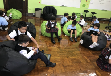 students reading on beanbag chairs