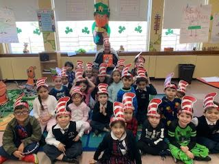 students with Dr. Seuss hats